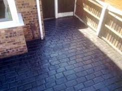 imprinted concrete patio with block paving pattern